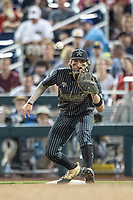 Vanderbilt Commodores first baseman Julian Infante (22) waits for a throw against the Michigan Wolverines during Game 2 of the NCAA College World Series Finals on June 25, 2019 at TD Ameritrade Park in Omaha, Nebraska. Vanderbilt defeated Michigan 4-1. (Andrew Woolley/Four Seam Images)