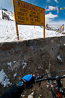 Point of view photo of altimeter on wrist of mountain biker at Khardung La at 18,380ft. the summit of the highest motorable road in the world.  Himalayan Mountains, Ladakh, India.