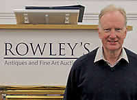 BNPS.co.uk (01202) 558833. <br /> Pic: Rowley's/DeepSouth/BNPS<br /> <br /> Pictured: Roddy Lloyd of Rowley's Auction House in Ely, Cambs. <br /> <br /> A rare Ecomobile designed by a madcap inventor that left Jeremy Clarkson speechless has sold for over £11,000.<br /> <br /> The 1995 Peraves Super Turbo was 12ft long, 4ft wide and essentially an enclosed motorcycle, but the driver had to put down its stabilisers every time the machine came to rest.<br /> <br /> Only 89 of the bizarre contraptions were ever made before the concept was scrapped, but not before it was tested on Jeremy Clarkson's Motorworld in 1996.