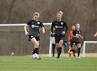 LOUISVILLE, KY - MARCH 13: Emina Ekic #13 of Racing Louisville FC runs the ball up the field during a game between West Virginia University and Racing Louisville FC at Thurman Hutchins Park on March 13, 2021 in Louisville, Kentucky.