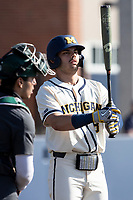 Michigan Wolverines designated hitter Jimmy Obertop (8) at the plate against the Michigan State Spartans on March 21, 2021 in NCAA baseball action at Ray Fisher Stadium in Ann Arbor, Michigan. Michigan scored 8 runs in the bottom of the ninth inning to defeat the Spartans 8-7. (Andrew Woolley/Four Seam Images)