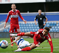 Middlesbrough's Marcus Tavernier is tackled by Queens Park Rangers Geoff Cameron<br /> <br /> Photographer Stephanie Meek/CameraSport<br /> <br /> The EFL Sky Bet Championship - Queens Park Rangers v Middlesbrough - Saturday 26th September 2020 - Loftus Road - London <br /> <br /> World Copyright © 2020 CameraSport. All rights reserved. 43 Linden Ave. Countesthorpe. Leicester. England. LE8 5PG - Tel: +44 (0) 116 277 4147 - admin@camerasport.com - www.camerasport.com