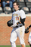 Matt Duffy #13 of the Tennessee Volunteers heads to the dugout after hitting a Grand Slam at Lindsey Nelson Stadium against the the Manhattan Jaspers on March 12, 2011 in Knoxville, Tennessee.  Tennessee won the first game of the double header 11-5.  Photo by Tony Farlow / Four Seam Images..