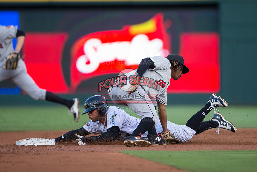 Indianapolis Indians shortstop Gift Ngoepe (17) applies the tag as Yoan Moncada (10) of the Charlotte Knights slides head first into second base at BB&T BallPark on June 16, 2017 in Charlotte, North Carolina.  The Knights defeated the Indians 12-4.  (Brian Westerholt/Four Seam Images)