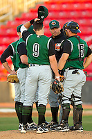 Augusta GreenJackets pitching coach Steve Kline #34 has a chat on the mound with Dan Burkhart #15, Adam Duvall #9 and Shawn Sanford #12 during the game against the Hickory Crawdads at L.P. Frans Stadium on April 29, 2011 in Hickory, North Carolina.   Photo by Brian Westerholt / Four Seam Images