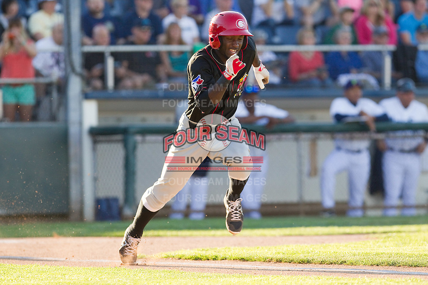 Roemon Fields #2 of the Vancouver Canadians hustles down the first base line during a game against the Everett AquaSox at Everett Memorial Stadium in Everett, Washington on July 9, 2014.  Everett defeated Vancouver 9-4.  (Ronnie Allen/Four Seam Images)