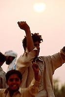 Boys and young men are dancing at sunset in the desert of Cholistan.<br /> 16.2.2001, Chenepir/Punjab<br /> Copyright: Christian-Ditsch.de<br /> [Inhaltsveraendernde Manipulation des Fotos nur nach ausdruecklicher Genehmigung des Fotografen. Vereinbarungen ueber Abtretung von Persoenlichkeitsrechten/Model Release der abgebildeten Person/Personen liegen nicht vor. NO MODEL RELEASE! Nur fuer Redaktionelle Zwecke. Don't publish without copyright Christian-Ditsch.de, Veroeffentlichung nur mit Fotografennennung, sowie gegen Honorar, MwSt. und Beleg. Konto: I N G - D i B a, IBAN DE58500105175400192269, BIC INGDDEFFXXX, Kontakt: post@christian-ditsch.de<br /> Bei der Bearbeitung der Dateiinformationen darf die Urheberkennzeichnung in den EXIF- und  IPTC-Daten nicht entfernt werden, diese sind in digitalen Medien nach §95c UrhG rechtlich geschuetzt. Der Urhebervermerk wird gemaess §13 UrhG verlangt.]