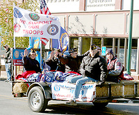 Marc Hayot/Herald Leader Members of American Legion Post 29 wave at the crowds as they ride by.