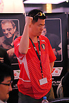 Brian Kang celebrates his full house after the board paired. He won a huge pot and busted Schneider.