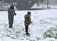 With severe weather warnings issued across the UK including the south and east of the country. Bedford had it's first significant snowfall in several years. After the lunchtime snow, suddenly snowmen sprang up all over the snow covered green spaces. Bedford, UK Sunday January 24th 2021<br /> <br /> Photo by Keith Mayhew