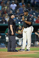 Ocelotes de Greensboro manager Miguel Perez (29) discusses a call with home plate umpire Jennifer Pawol during the game against the Hickory Crawdads at First National Bank Field on June 11, 2019 in Greensboro, North Carolina. The Crawdads defeated the Ocelotes 2-1. (Brian Westerholt/Four Seam Images)