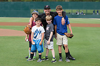 Kannapolis Intimidators relief pitcher Kyle Kubat (1) poses for a photo with four young men who had the opportunity to throw out ceremonial first pitches prior to the South Atlantic League game between the Kannapolis Intimidators and the Hickory Crawdads at Kannapolis Intimidators Stadium on April 22, 2017 in Kannapolis, North Carolina.  The Intimidators defeated the Crawdads 10-9 in 12 innings.  (Brian Westerholt/Four Seam Images)