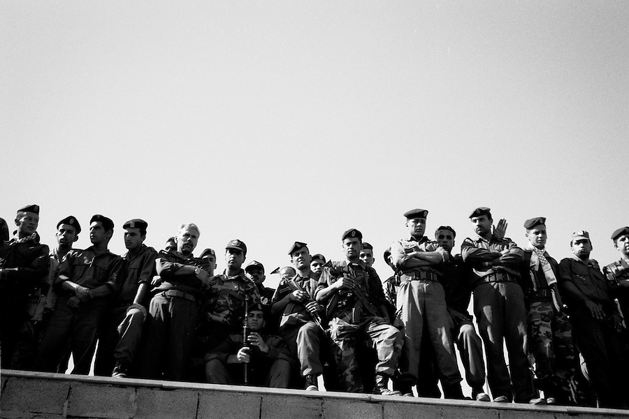 Palestinian Authority soldiers watching over crowd outside the walls of the Muqata presidential compound the day of Yasser Arafat's funeral.