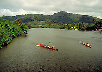 Two outrigger canoes race up the Wailua River in Kauai, Hawaii, boats, boat. Hawaii, Wailua River, Kauai.