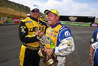 Jul. 20, 2014; Morrison, CO, USA; Jeg Coughlin Jr (left) congratulates NHRA pro stock driver Allen Johnson after winning the Mile High Nationals at Bandimere Speedway. Mandatory Credit: Mark J. Rebilas-