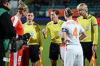 20160302 – DEN HAAG ,  NEDERLAND : Ukrainian referees Kateryna Monzul (middle) , Natalia Rachynska and Maryna Striletska pictured with captains Dutch Mandy Van Den Berg (4) and Swiss Caroline Abbe (15) during the Olympic Qualification Tournament  soccer game between the women teams of Switzerland and The Netherlands, The first game for both teams in the Olympic Qualification Tournament for the Olympic games in Rio de Janeiro - Brasil, Wednesday 2 March 2016 at Kyocera Stadium in The Hague , Netherlands  PHOTO DAVID CATRY