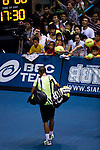 BANGKOK, THAILAND - OCTOBER 02:  Rafael Nadal of Spain leaves the court after loosing against compatriot Guillermo Garcia-Lopez during the Day 8 of the PTT Thailand Open at Impact Arena on October 2, 2010 in Bangkok, Thailand. Photo by Victor Fraile / The Power of Sport Images