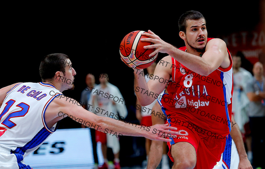 France's Nando De Colo (L) vies with Serbia's Nemanja Bjelica (R) during European championship basketball match for third place between France and Serbia on September 20, 2015 in Lille, France  (credit image & photo: Pedja Milosavljevic / STARSPORT)