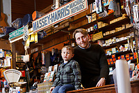 Pictured: Thomas Lewis Jones (R) with his son Arthur Lewis Jones at the counter Hafod Hardware store in Rhayader, mid Wales, UK. Thursday 05 December 2019.<br /> Re: Shop owner Thomas Lewis Jones has made a Christmas advert starring Arthur Lewis Jones, his two-year-old son costing only £100.<br /> Hafod Hardware in Rhayader, Powys, has been making festive adverts for several years.<br /> This year's advert sees Arthur setting up the shop along with members of his family.