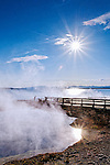 West Thumb Geyser Basin, while the smallest of the developed geothermal areas, is the most scenic due to its location along the shoreline of Yellowstone Lake.  Early mornings create stunning steamy scenes with the caldera edge and Tetons as backdrop, mid day creates deep colors in hot springs.  Yellowstone National Park, Wyoming.