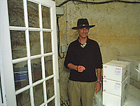 Edouard Pisani wearing a hat in his wine cellar at Chateau de Targe in Saumur Champigny, Maine et Loire France