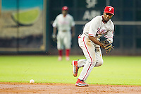 Philadelphia Phillies shortstop Jimmy Rollins #11 tracks a ground ball during the Major League baseball game against the Houston Astros on September 16th, 2012 at Minute Maid Park in Houston, Texas. The Astros defeated the Phillies 7-6. (Andrew Woolley/Four Seam Images).