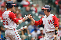 Houston Cougars Blake Kelso scores against the Texas Tech Red Raiders on Sunday March 7th, 2100 at the Astros College Classic in Houston's Minute Maid Park.  (Photo by Andrew Woolley / Four Seam Images)
