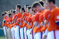 Members of the Clemson Tigers listen to the National Anthem before a game against the University of Alabama-Birmingham on Feb. 17, 2012, at Doug Kingsmore Stadium in Clemson, South Carolina. (Tom Priddy/Four Seam Images)