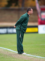 Miami head coach Tom Anagnost yells to his team during the game at Ludwig Field in College Park, MD.  Maryland defeated Miami, 2-1, in overtime.