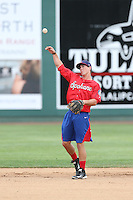 Dylan Moore (19) of the Spokane Indians in the field before a game against the Everett AquaSox at Everett Memorial Stadium on July 25, 2015 in Everett, Washington. Spokane defeated Everett, 10-1. (Larry Goren/Four Seam Images)