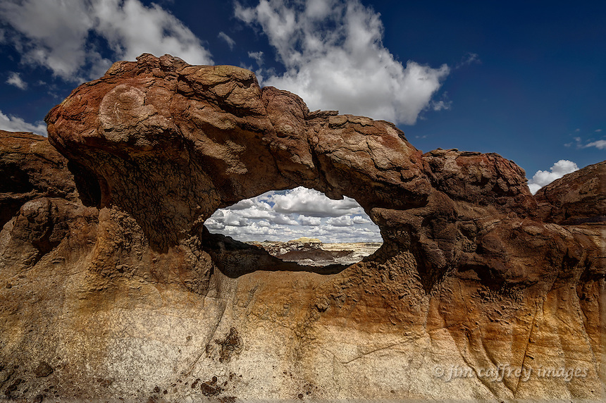 A view through the Bisti Arch in Alamo Wash in the Bisti Wilderness of northwest New Mexico.