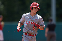Patrick Bailey (5) of the North Carolina State Wolfpack rounds the bases after hitting a home run against the Northeastern Huskies at Doak Field at Dail Park on June 2, 2018 in Raleigh, North Carolina. The Wolfpack defeated the Huskies 9-2. (Brian Westerholt/Four Seam Images)