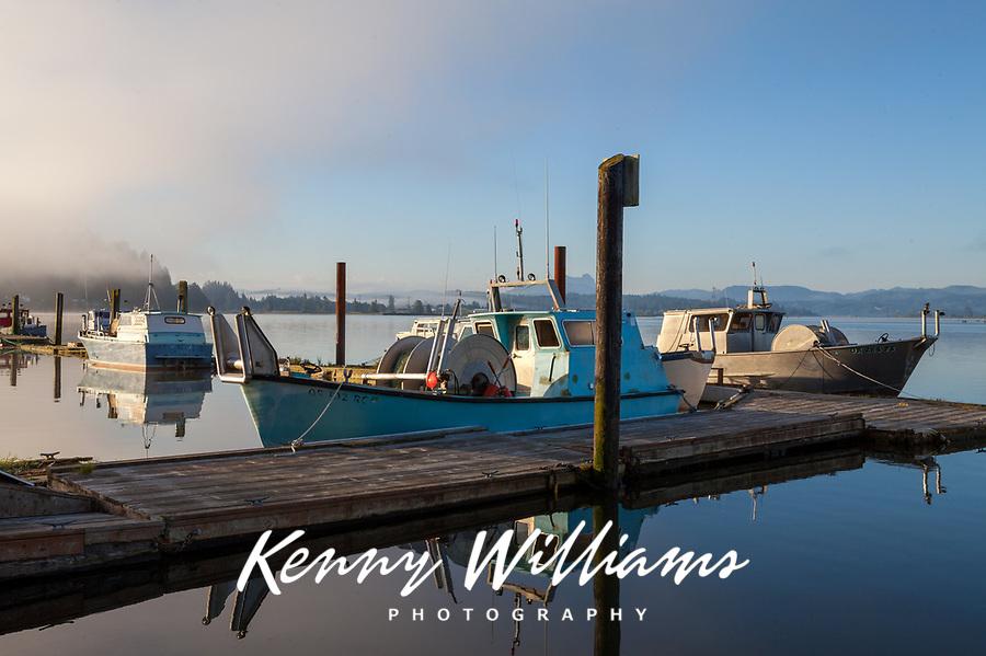 Fishing Boats in the Fog, Astoria Marina, Oregon, USA.