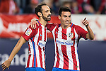 Nicolas Gaitan of Atletico de Madrid celebrates with teammate Juanfran during their La Liga match between Atletico de Madrid and Granada CF at the Vicente Calderon Stadium on 15 October 2016 in Madrid, Spain. Photo by Diego Gonzalez Souto / Power Sport Images
