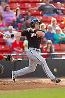 Kale Kiser (9) of the Kannapolis Intimidators follows through on his swing against the Hickory Crawdads at L.P. Frans Stadium on May 25, 2013 in Hickory, North Carolina.  The Crawdads defeated the Intimidators 14-3.  (Brian Westerholt/Four Seam Images)
