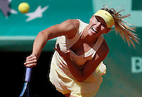 Maria Sharapova of Russia serves against Andrea Petkovic of Germany in the quarter final match of the French Open tennis tournament in Roland Garros stadium in Paris, Wednesday June 1, 2011. Sharapova won in two sets 6-0, 6-3. (foto: Srdjan Stevanovic/Starsportphoto ©)