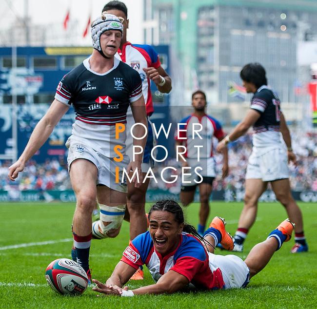 Hong Kong vs American Samoa during the Cathay Pacific / HSBC Hong Kong Sevens at the Hong Kong Stadium on 28 March 2014 in Hong Kong, China. Photo by Juan Flor / Power Sport Images