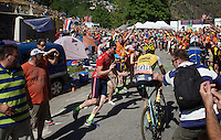Tom Leezer (NLD/LottoNL-Jumbo) experiencing the craziness at the Dutch Corner (nr7) up Alpe d'Huez as he gets a little push by the fans<br /> <br /> stage 20: Modane Valfréjus - Alpe d'Huez (111km)<br /> 2015 Tour de France
