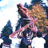 Stanley Park, Vancouver, BC, British Columbia, Canada - Native American Indians erecting  Nisga'a Totem Pole at Brockton Point