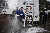 Adrie Van der Poel (after who'm this race is called) simply cleaning his sons' bikes post-race (while they're watching)<br /> <br /> Grand Prix Adrie van der Poel, Hoogerheide 2016<br /> UCI CX World Cup