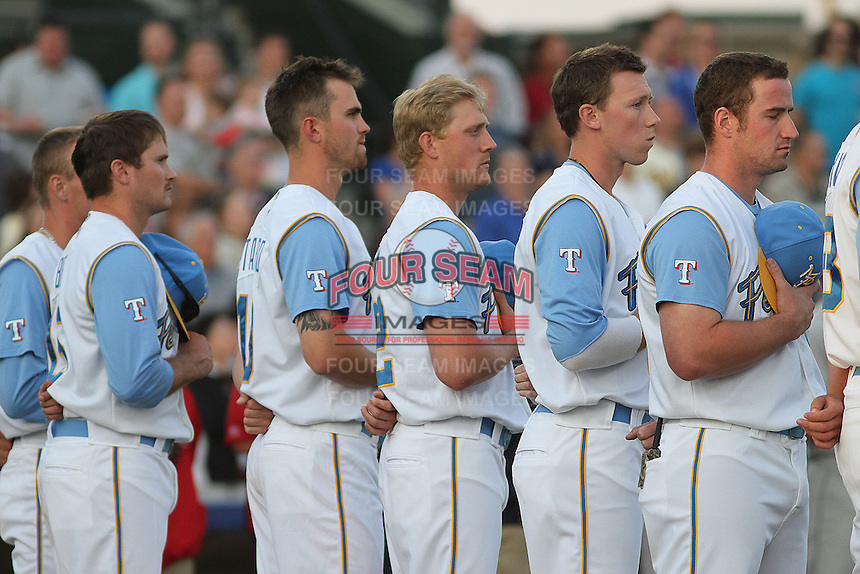Myrtle Beach Pelicans players during the national anthem before a game against the Salem Red Sox at Ticketreturn.com Field at Pelicans Ballpark on April 3, 2014 in Myrtle Beach, South Carolina. Salem defeated Myrtle Beach 10-2. (Robert Gurganus/Four Seam Images)
