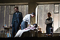 London, UK. 27.10.2014. Jonathan Miller's production, for English National Opera, of LA BOHEME, by Giacomo Puccini, opens at the London Coliseum. Rising star soprano, Angel Blue, makes her role debut as Mimi. Picture shows: George Humphreys (Schaunard), David Butt Philip (Rodolfo), Angel Blue (Mimi) and Barnaby Rea (Colline). Photograph © Jane Hobson.