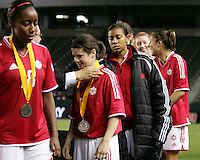 Diana Matheson receives her runners-up medal. USA captured the 2006 Gold Cup at Home Depot stadium in Carson, California on November 26 2006 thanks to a penalty kick call by the referee with only seconds remaining in the last period of overtime. With the penalty kick score USA beat Canada 2-1.
