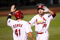 Chris Swauger (28) of the Springfield Cardinals celebrates with Jamie Romak (41) after hitting a home run during a game against the Arkansas Travelers at Hammons Field on July 25, 2012 in Springfield, Missouri. (David Welker/Four Seam Images)