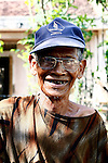 A Bahnar man smiles for a photograph near the Central Highlands town of Kon Tum, Vietnam. The Bahnar are one of more than two dozen hill tribes once known in the West as Montagnards, but who are now called the Dega. April 14, 2012.