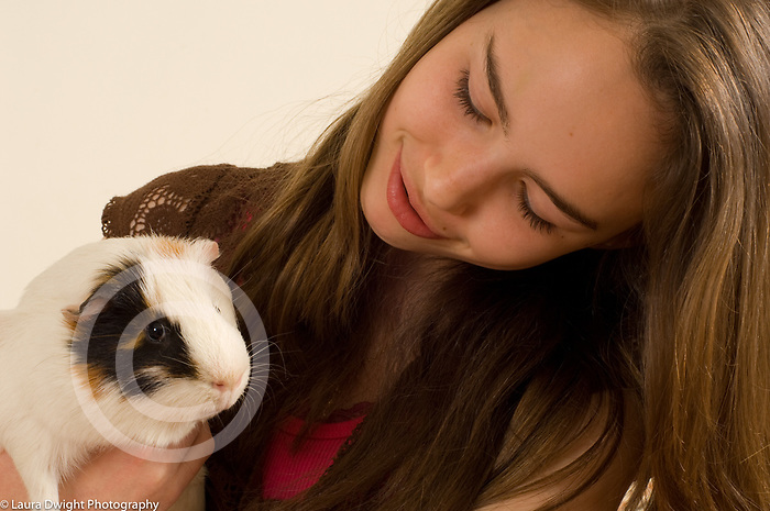 13 year old girl with pet guinea pig
