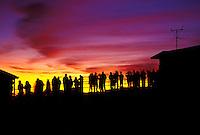 A line of people view a beautiful Haleakala sunrise
