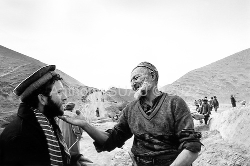 Northern Afghanistan <br /> October 2001<br /> <br /> Conversing with the local population in their own language, American John Weaver also respects the traditions of the country. He has in turn earned the respect of the Afghans who refer to him as simply, Mr. John.