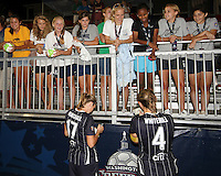Nikki Marshall #17 and Cat Whitehill #4 of the Washington Freedom sign autographs at the end of  a WPS match against the Philadelphia Independence on August 4 2010 at the Maryland Soccerplex, in Boyds, Maryland. Freedom won 2-0.
