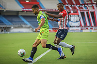 BARRANQUIILLA - COLOMBIA, 20-03-2021: Willer Dita del Junior y Danny Cano del Pereira durante el partido por la fecha 13 de la Liga BetPlay DIMAYOR I 2021 entre Atlético Junior y Deportivo Pereira jugado en el estadio Metropolitano Roberto Meléndez de la ciudad de Barranquilla. / Willer Dita of Junior and Danny Cano of Pereira during match for date 13 as part of BetPlay DIMAYOR League I 2021 between Atletico Junior and Deportivo Pereira played at Metropolitano Roberto Melendez stadium in Barranquilla city. Photo: VizzorImage / Jairo Cassiani / Cont